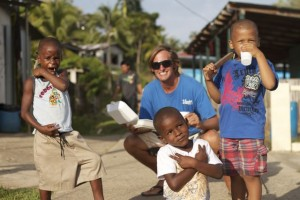 Founder of Give and Surf, Neil Christiansen with some children of Bahia Honda